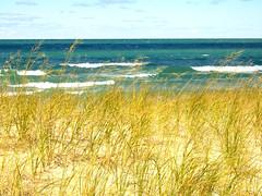 Cathead Bay (joeldinda) Tags: vacation michigan leelanaucounty leelanaustatepark greatlakes lakemichigan water waterfront beach cloud tallgrass family sky 1038 2005 fujifilm fuji finepixf10 f10 finepix fujifilmfinepixf10 pocketcam september