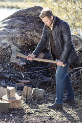 Man wearing a wax jacket chopping logs with an axe (Rydale Country Clothing) Tags: man chopping logs country fire wood wax jacket coat outfit fashion