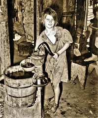 May's Avenue camp (vicinity), an agricultural workers' shacktown. Child draws water from pump c.1980 NARA RG16-H-009-01-di1394 (over 21 MILLION views Thanks) Tags: children historical hygiene water waterpump oklahomacity ok us girl