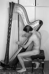 Brooding Apollo (Karsten Fatur) Tags: music musician harp harpist portrait portraitphotography photography bw blackandwhite greyscale monochrome ljubljana slovenija slovenia balkan europe naked nude skin apollo gay lgbt lgbtq queer queerart gaymen gayart