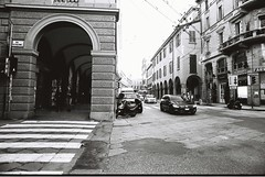 Bologna (goodfella2459) Tags: nikonf4 afnikkor24mmf28dlens cinestillbwxx 35mm blackandwhite film analog city streets bologna italy road buildings cars bwfp