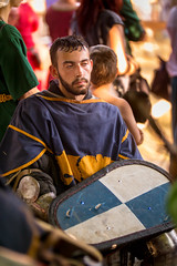 Medieval soldier resting after a battle