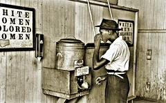 African-Amerian male gets drink from segregated water cooler at the street car terminal NARA RG16-H-009-01-di1404 (over 21 MILLION views Thanks) Tags: africanamerican historical minority segregation oklahomacity ok us boy youngman drinkingfountain