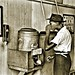 African-Amerian male gets drink from segregated water cooler at the street car terminal NARA RG16-H-009-01-di1404