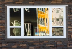 In the Window (Karen_Chappell) Tags: window reflection house building stjohns abstract yellow brick stone glass reflections home newfoundland nfld architecture buildings windows brown white atlanticcanada avalonpeninsula eastcoast canada canonef24105mmf4lisusm