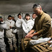 Sailor conducts a class to show soldiers from Japan Ground Self-Defense Force a medical bag during exercise