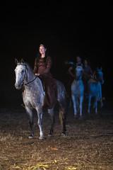 Reenactors riding horses
