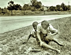 Two Boys wrestling on side of road ca1980 NARA RG16-H-009-01-di1388 (over 21 MILLION views Thanks) Tags: africanamerican historical minority playing nc us boys wrestling