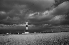 Dungeness New Lighthouse (Peter Meade) Tags: pjmeade petermeade dungeness dungenessnewlighthouse lighthouse sky stormy shingle clouds dramaticsky kent ilfordfilm delta400 blackandwhitefilm canonef24105mmf4lisusm