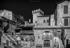 Capalbio: il borgo (B&W)/ Capalbio: the village (B&W) (Eugenio GV Costa) Tags: approvato borgo case cielo village homes sky casedipietra toscana italia capalbio bianconero blackandawhite stonehouses tuscany italy blackwhite blackandwhite bw