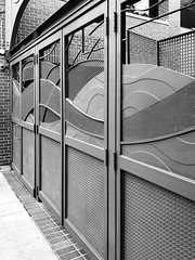 Noir on Thursday (Melinda * Young) Tags: monochrome gate door metal blackandwhite berkeley downtown perspective streetscape landscape curves architecture