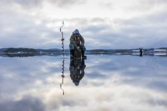 Ice fishing on a mirror like ice (VisitLakeland) Tags: finland kallavesi kuopio lakeland heijastus ice järvi jää lake luonto maisema mirror nature outdoor reflection scenery talvi winter