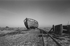 Dungeness fishing boat (Peter Meade) Tags: petermeade pjmeade dungeness dungenessbeach dungenesswreck dungenessboat fishingboat dungenessfishingboat derelict abandoned decaying beached classicview ilfordfilm ilforddelta400 delta400 blackandwhitefilm canonef24105mmf4lisusm