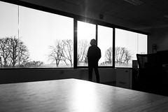In meditation (maxlaurenzi) Tags: black white dramatic cinematic person lines light movie style silhouette window geometry trees elements objects