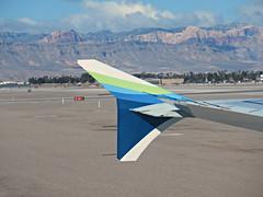 arrival into LAS (kenjet) Tags: landscape mountain desert wing vegas las klas mccarran lasvegas mccarraninternationalairport alaska alaskaairlines winglet wingtip boeing 737 737900er 739 blue