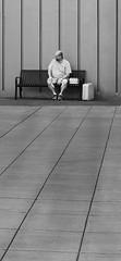 Waiting (Robbins Drones) Tags: oregon oregoncity blackwhite bnw monochrome wait waiting man luggage xt2 fujifilm on1pics bench lines