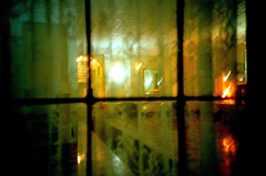 The Quiet of the Night: Peeping Tom (Gabriella Ollandini) Tags: illuminated night streetphotography 35mm istillshootfilm filmisnotdead filmphotography film filmcamera cinematic atmospheric blur window glow city urban foyer nyc analog analogica analogue ricoh kr5 kodak 200 helios zenit quiet eerie