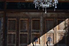 Cowpoke Castle (MPnormaleye) Tags: paneling patterns woodwork wood woodgrain detail texture chandelier glass elegant rough lensbaby 35mm utata utata:project=tw718 spark
