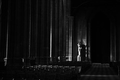 In the Halls (Rachael Faye) Tags: black white bw cathedral statue stone pillars church france orlean