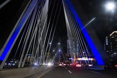 Zakim Bridge by Night (brucetopher) Tags: city night highway driving drive road travel light lights blue bridge festive lit lighting bluelight cable