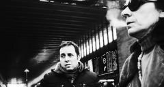Double indemnity. (Baz 120) Tags: candid candidstreet candidportrait city candidface street streetphoto streetcandid streetportrait strangers rome roma ricohgrii europe women monochrome monotone mono noiretblanc bw blackandwhite urban life portrait people provoke italy italia grittystreetphotography faces decisivemoment