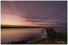 Keep Smiling! (Mark Edgar) Tags: northernireland coantrim islandmagee brown'sbay tranquil water sea purplelight goldenlight sunset smileyface rock