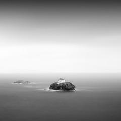 Lonely island VI (ilias varelas) Tags: sky sea seascape square seafront dark blackandwhite bw nature mood mono monochrome mist light landscape longexposure island greece atmosphere