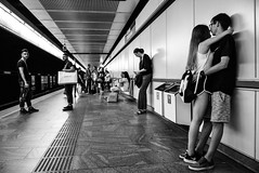 First love (Roi.C) Tags: monochrome black bw people outside outdoor candid ligh europe nikon d5300 nikkor photography photo digital shot street city human humans persons picture image camera interesting talking 18140mm man composition white portrait face sitting town urban blackandwhite standing travel train station girl youngwoman trainstation 2017 vienna austria