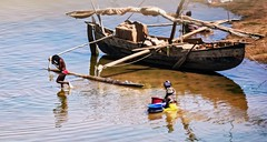 River Boat (Rod Waddington) Tags: africa african afrique afrika madagascar malagasy river boat riverboat trader women washing group people traditional cargo sail unfurled
