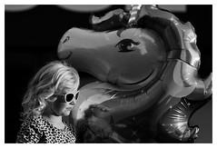 (David Ian Ross) Tags: child shades unicorn sunlight carnival town passing balloon street