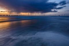 The rising light of day (Mojekieke) Tags: westenschouwen depunt strand sunrise westerschouwen zee zeeland zonsopkomst beach longexposure sun sea rain clouds