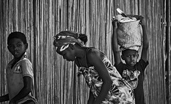 Street Madagascar (Rod Waddington) Tags: africa african afrique afrika madagascar malagasy streetphotography street group blackandwhite mono monochrome family mother children boys bamboo fence outdoor
