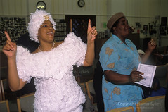 Spiritual dancing. Church of God of Prophecy west London. (Homer Sykes) Tags: uk london woman hat community singing ethnic ethnicity bestclothes holydance churchofgodofprophecycommunityethnicethnicitysinginlondonukchurchofgodofprophecy england black english church women britain christian british christianity congregation worshippers londonstock thestormispassingover 1990s 90s