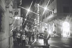 Roma (goodfella2459) Tags: nikonf4 afnikkor50mmf14dlens ilfordsuperxp2400 35mm c41 blackandwhite film analog city night streets pedestrians filter crossstarfilter roma italy rome buildings light lensfiltersgroup bwfp