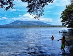 Swimming in the shadow (stewardsonjp1) Tags: worldwide cloud sky volcano concepcion water eco exotic travel natural beauty trees man boy swing splash swim lake island nicaragua omotepe