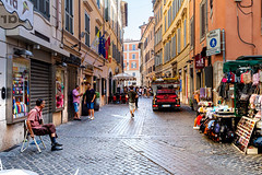 A normal day in a street in Rome (Arne.Holt) Tags: street outside rome people ladder car shops daylight italy flag restaurant houses