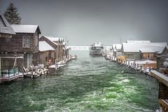 Snowy Harbor (downstreamer) Tags: lakemichigan leelanau minoltamdzoom3570mm135 boat building dock fishtown harbor leland outbuilding shack winter michigan unitedstatesofamerica