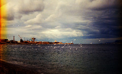 Seagulls (Victoria Yarlikova) Tags: sicily film analog messina sicilia zenit122 35mm expiredfilm scan scanfromnegative плёнка clouds winter seagulls maregrosso zonafalcata beach industrial darkroom epsonperfectionv700 retro retrocolours filmphotography grain lightleak filmcamera