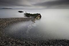(annemcgr) Tags: malahide rocks beach shingle clouds sea le longexposure