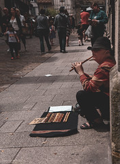 ..But I will continue to play the flute.. (erlingraahede) Tags: 2019 summer musiconthestreet shootingpeople poetic music melancholic bedifferent mutedcolours vintage canon streetphotography france quimper people raahedep