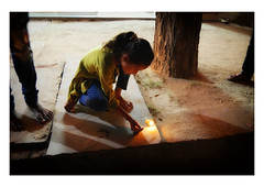 lighting the flame (handheld-films) Tags: india divali diwali traditional hindu festival festivities light pot flame lamplight night dark festivaloflights celebrations deepavali indian rural village rajasthan travel documentary people girl