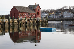 Quite Harbor - Motif #1 (brucetopher) Tags: motif motif1 motifno1 motifnumberone motifnumber1 one 1 red shack shed lobstershack lobster harbor fisherman lobsterman house building architecture newengland rockport rockportharbor water reflection reflect still calm winter windless quaint boat boats blue float ocean sea bay cove dock pier landing fishermen pilings granite wooden