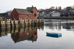 Motif #1 and a Blue Skiff (brucetopher) Tags: motif motif1 motifno1 motifnumberone motifnumber1 one 1 red shack shed lobstershack lobster harbor fisherman lobsterman house building architecture newengland rockport rockportharbor water reflection reflect still calm winter windless quaint boat boats blue float ocean sea bay cove dock pier landing fishermen pilings granite wooden