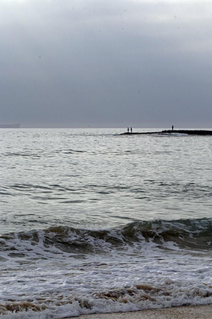Fishing off the rocks at Moonee Beach