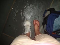 2428423320087975127IvarsL_ph (Zappacity) Tags: mismatchedshoes oneflipflop trainer sneaker teengirl wet rain street ghetto