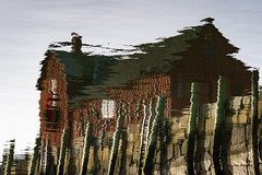 Reflected - Motif #1 (brucetopher) Tags: motif motif1 motifno1 motifnumberone motifnumber1 one 1 red shack shed lobstershack lobster harbor fisherman lobsterman house building architecture newengland rockport rockportharbor water reflection reflect still calm winter windless quaint bay cove dock pilings wooden granite pier