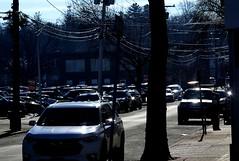 Reflecting Sunlight (en tee gee) Tags: cars wires sunlight street parkinglot