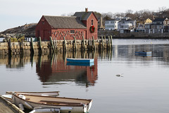 Motif #1 and Boats (brucetopher) Tags: motif motif1 motifno1 motifnumberone motifnumber1 one 1 red shack shed lobstershack lobster harbor fisherman lobsterman house building architecture newengland rockport rockportharbor water reflection reflect still calm winter windless quaint boat boats blue float ocean sea bay cove dock pier landing fishermen pilings granite wooden