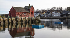 Motif #1 Panorama (brucetopher) Tags: motif motif1 motifno1 motifnumberone motifnumber1 one 1 red shack shed lobstershack lobster harbor fisherman lobsterman house building architecture newengland rockport rockportharbor water reflection reflect still calm winter windless quaint boat boats blue float ocean sea bay cove dock pier landing fishermen pilings granite wooden