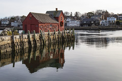 Motif #1 and Calm Water (brucetopher) Tags: motif motif1 motifno1 motifnumberone motifnumber1 one 1 red shack shed lobstershack lobster harbor fisherman lobsterman house building architecture newengland rockport rockportharbor water reflection reflect still calm winter windless quaint bay cove dock pilings wooden granite pier